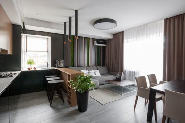 客厅的设计是和餐厅联在一起的,厨房的设计采用的是开放式的,因此使整个空间更加的大气,而独特的造型设计以及吧台的使用又划分了整个空间的功能性。