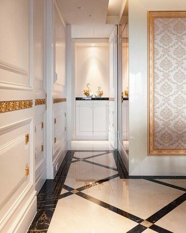 金色缕空线板从玄关处起始,游走于等高腰线的公共空间墙面柜门上, 精巧拿捏出不流俗丽的巧致奢华,让空间感不断延伸。