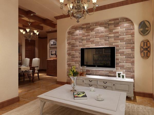 客厅吊顶采用井字形加吊灯装饰沙发背景墙是圆拱形石膏线造型,下面是照片墙,记录生活精美瞬间。再下面是护墙板。电视背景墙采用的是圆拱形里面是墙砖,增加地中海特点。