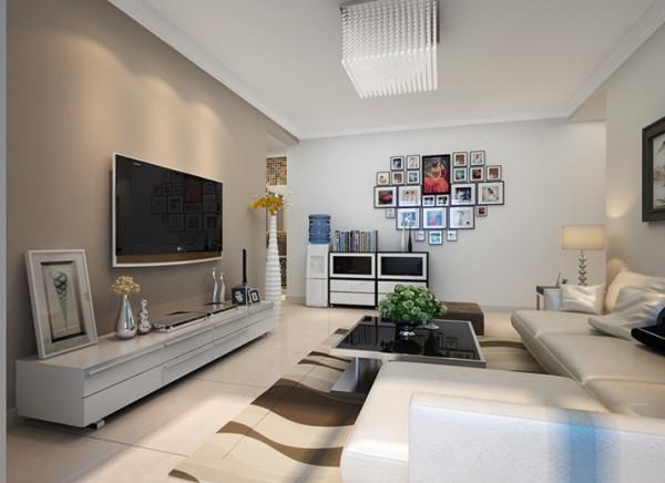 在整个的设计过程中,以简约作为基调,无任何造型的电视背景墙以咖色饰面,以及经典的黑白配,勾勒出整个空间更突出简约的大气和时尚,体现了主人的文化品位;地面铺设浅色系的大地砖,让整个空间更温馨。