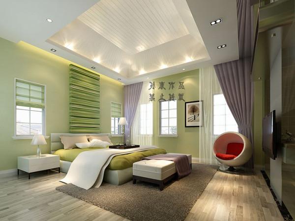 次卧也是呈现绿色的感觉,一把红色圆形躺椅点缀出房间的活力