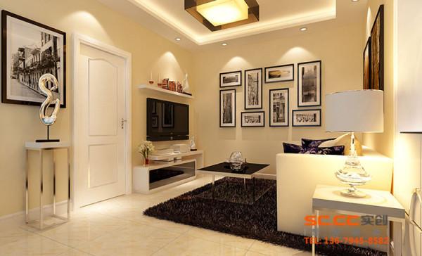 设计理念:简单时尚的电视背景墙和墙纸突显了设计风格。以白色为主的软包沙发,彰显现代简洁个性,但又不失典雅的气质。 亮点:挑空式的吊顶,现代式的灯具,使整个空间看起来更宽敞,纠正了房屋矮的缺陷;