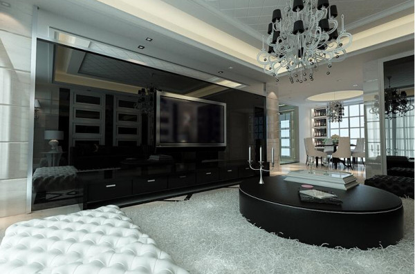 电视背景墙整个采用了亮黑色的大理石铺设,光泽而有质感。配以地面超柔软的纯白色地毯,强烈的色差提升出不一样的质感。
