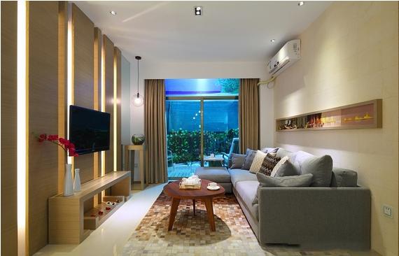 客厅的造型设计也是相当的独特,电视背景墙的设计显得干练十分的大气。和沙发背景墙上的造型相呼应。落地窗的景色也形成了一幅美丽的装饰画。
