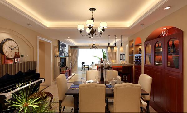 餐厅以简洁呼应为主。酒柜采用三段式的分割设计,地面顶面呼应式设计,色系定位为暖色系