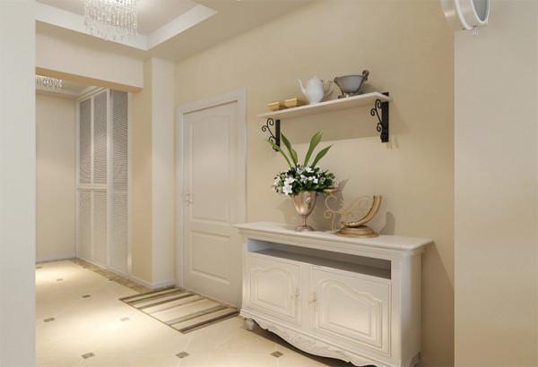 入户玄关的设计以精美的铁艺装饰架板配合百叶鞋柜的搭配,是一种时尚的气质和体现。也是整体空间最为耀眼的地方。