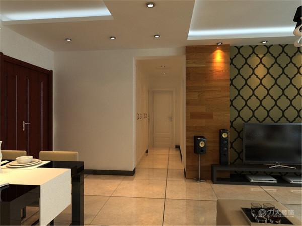 台灯柜用了黑色烤漆和不锈钢相搭配,和茶几相呼应,电视柜也相应的选择了黑色烤漆的,整体家具和谐统一。