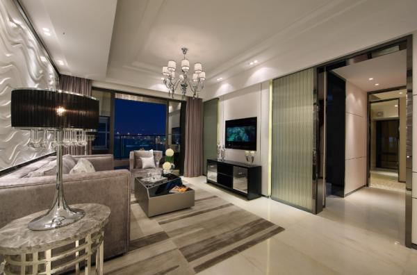 客厅:以地砖石材玻璃为主体营造出强烈的现代前卫风格而不失温馨
