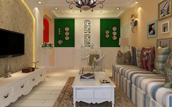 以电视背景墙为分界线,把走廊分为两部分,入户走廊处用于鞋柜的摆放,简约优雅的装饰鞋柜及挂式圆盘,配以墙面的条纹护墙板,让人眼前一亮,且富有层次感,拉伸空间。