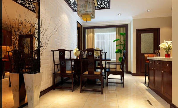 餐厅采用了茶色玻璃和魔宫性质的石膏板雕刻,使用花梨木封边充分的诠释了现代与古典的完美的结合