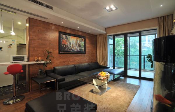 沙发背景墙使用了木质墙纸,对于整个空间具有了更多的自然,环保之意。