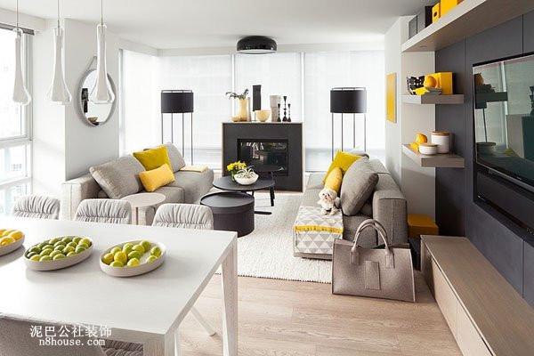 黑白撞色的背景墙,突出现代现代直线条的简约,彩色抱枕也是客厅的亮点之一