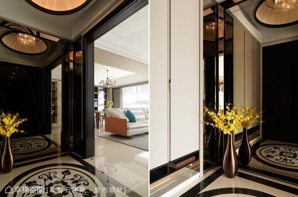 入门的端景立面以茶镜来放大空间感,四周包覆着钛金属边框,并采导角的形式,增加整体的细腻度;地坪上,则以拼花跳色来表现迎宾意象