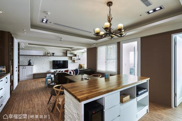 接连餐桌规划的中岛吧台,以粗犷文化石立面更添氛围层次,并创造出流畅的环状动线。