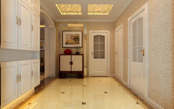 入户玄关是一个单独的区域,通过地面的瓷砖拼贴显得区域更加明确,顶面用的花格吊顶和反光效果,让整个门厅显得更加温馨。