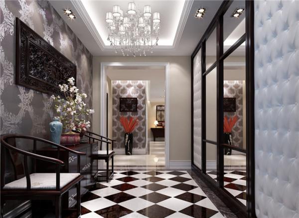 门厅设计: 首先映入眼帘的是黑白灰色调的门厅,紫檀与白色软包的巧妙结合。硬与软,黑与白整个空间在设计师精心搭配之下散发出金贵之气