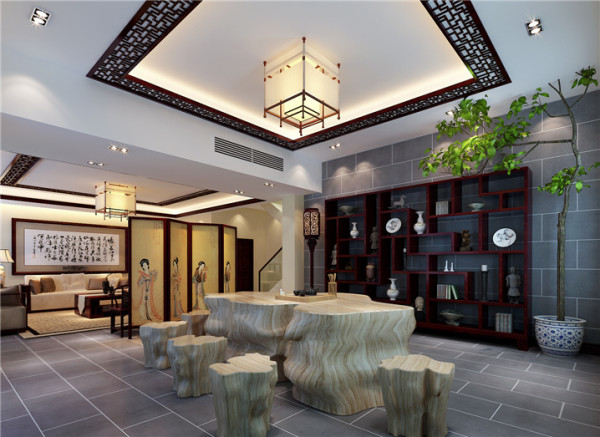中式茶几设计: 与客厅只有一个屏风的间隔,就是会客空间,茶几与凳子都是主人钟爱的木雕,古朴而木香。宽敞的空间,让来访的客人流连忘返