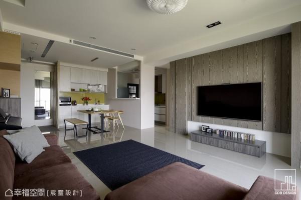 系统收纳创造电视机柜的收纳需求,搭配木作于立面的纵向造型线条,电视主墙成为利落而带有人文感受视觉重心。