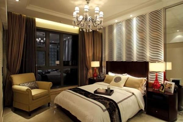 卧室的装修设计:舒适的大床,有特色的背景墙设计