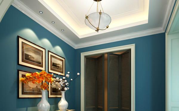 门厅的大空间经过后期调整,把它划为三个区域,分别为门厅玄关,鞋帽间及过道,满足了使用功能的同时达到了美观的效果