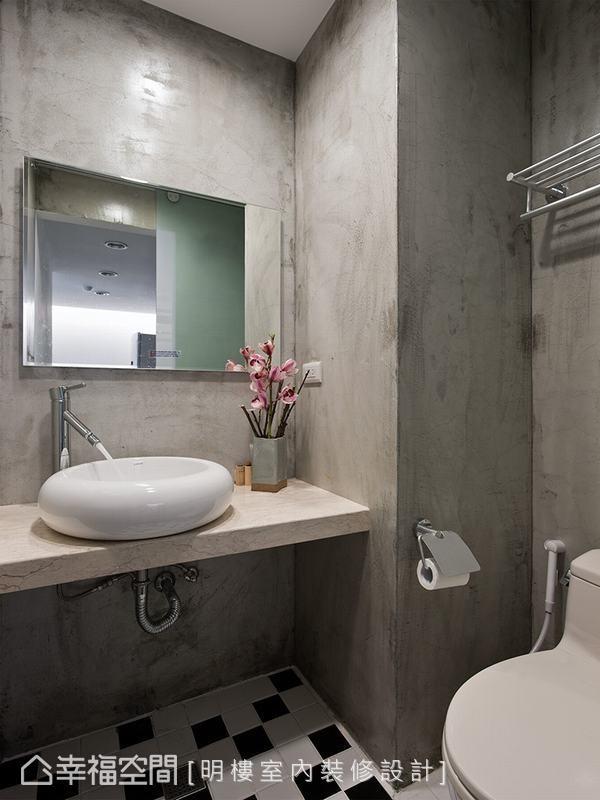 明楼设计以清水模形设计维持共享空间的冷调奢华感,地坪搭配马赛克地砖,营造出时尚复古味。