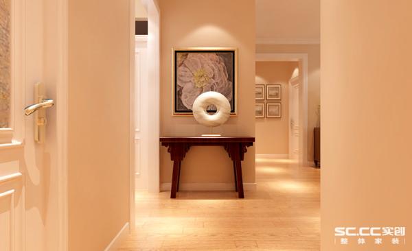 门厅设计: 门厅的玄关柜设计突出中式的隼牟结构,简单雕花,可以突出业主的展示收藏品,更增添了一丝品味