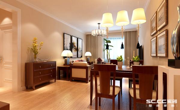 客厅设计: 客厅这个吊顶简单没有过多繁琐吊顶造型,使得空间的延生感加强,餐厅灯具层次感十足,造型简单