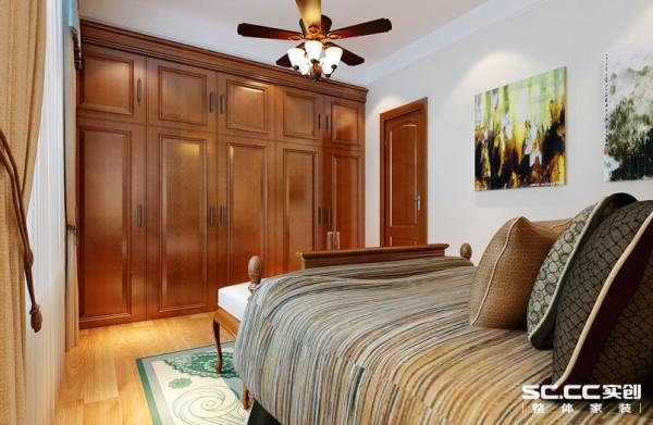 卧室设计: 本套案例卧室比较温馨,没有太多浮夸的装饰,只是简单的布艺、衣柜和装饰画。就显得各位静谧、温暖。
