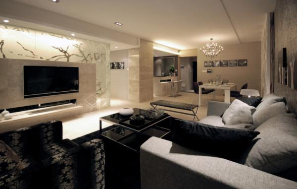 客厅的装修设计:黑、白、灰色三色的混合运用使室内充满了色彩间相互融合的撞击