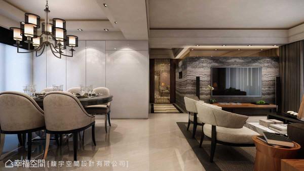 客厅电视墙以L型延伸的大面石材,铺陈空间的大器及稳定感,温润质地的品味家具,定义人文时尚的风格主轴。