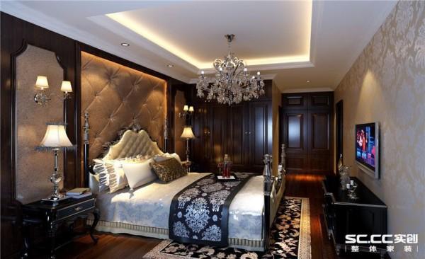 卧室设计: 主卧对于业主来说是一个较私密的空间,所以他选择了颜色比较沉稳的木作结合软包来饰面,配上深色的地板,对于五十岁左右的业主来说还是比较相称的