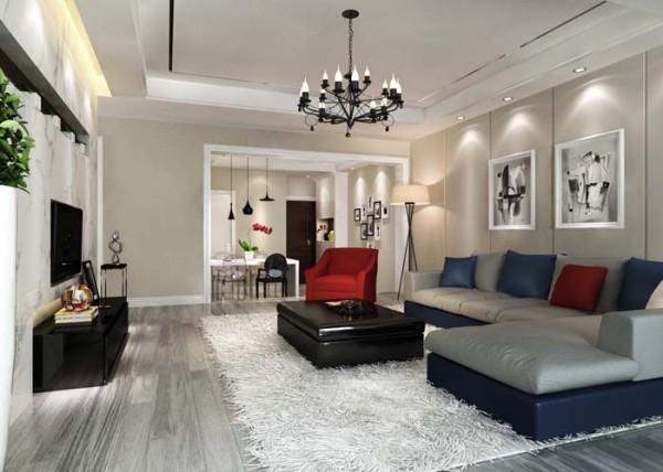 设计师在设计客厅区域时,运用线条感很可的茶几、电礼柜和灰色的地板搭配,让整个空间,干净有层次。电视强运用石材,让整个空间线条感很强,并且有档次。