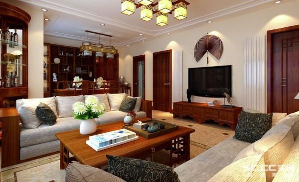 客厅设计理念:客厅里,精致的吊灯,玲珑花格,名家字画,一派中式风情的高尚生活态度。有看不尽春色的户外江景,有舒适的多功能室以茶会友,更有华丽姿态的午栖床