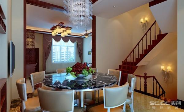 餐厅设计: 红木、青花瓷、紫砂茶壶以及一些红木工艺品等都体现了浓郁的东方之美,这正是新中式古典主义风格与其它风格所不同的地方
