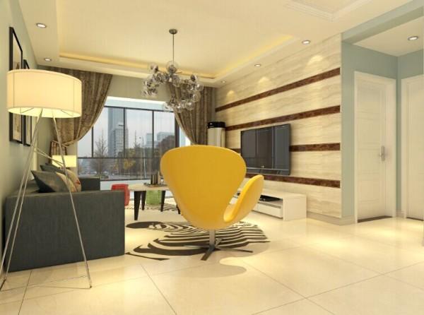 石材铺贴的电视背景墙简洁、大气,配上灰色的布艺沙发整体温馨十足。