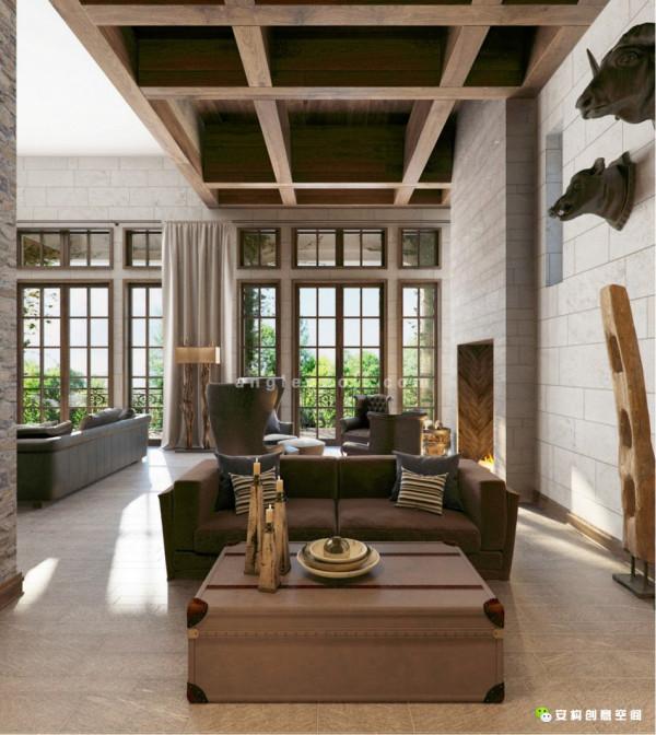 墙面用大理石装饰,壁炉的颜色与墙面相互呼应,其前面茶几的选择可谓是设计感十足,用木条密封在树脂中,使空间变得更加有趣。