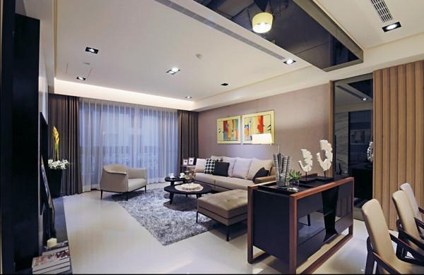 客厅与餐厅之间,利用天花板上的立体灰镜造型与活动腰柜微妙界定。