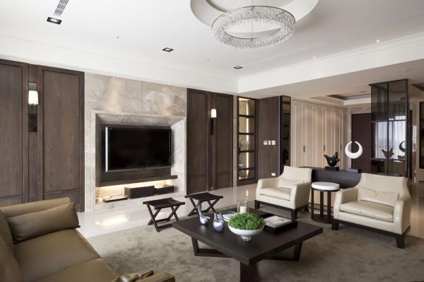 电视背景墙的设计也很美观,大理石的设计让人一种庄重之感。