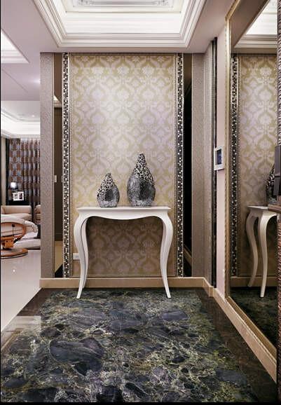 玄关进门用来屏障客厅的端景拥有超精緻的工艺细节,设计师混搭多媒材的高超技巧,让奢华感油然而生