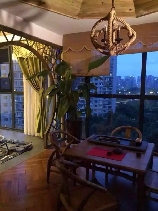 休闲区域,业之峰装饰公司设计师在设计休息区域,运用中式人休息桌、圆拱型中式门洞,中式灯具等搭配运用。