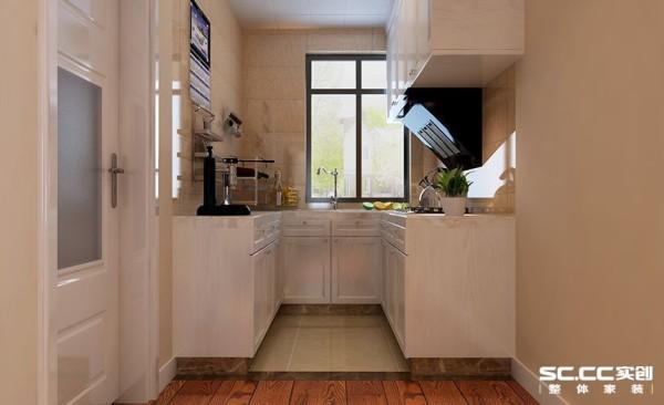 进门后左边是一个厨房,整体白色,看起来干净整洁