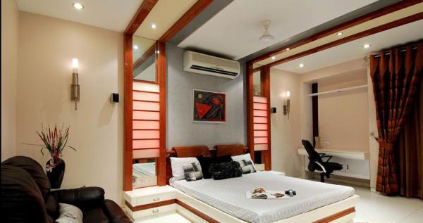 .天花板与卧室背景墙相接在视觉上延伸了空间。