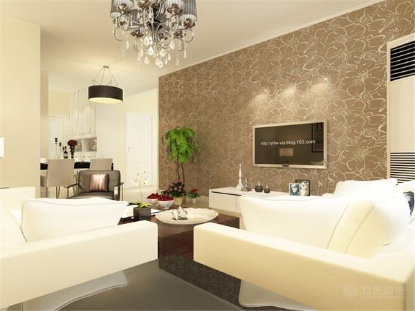 客厅只有沙发墙和连接阳台的墙上做了吊顶。整体的墙面是淡黄色的乳胶漆,电视背景墙贴的是深色的壁纸边上是石膏圈边,地面是浅色的木地板,沙发、电视柜选择的是浅色的,所以茶几选择了深色的。