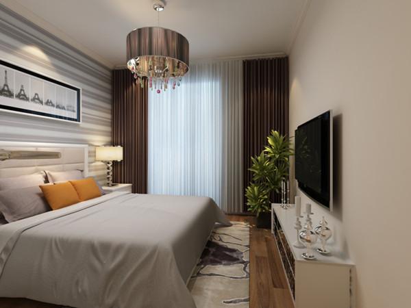 卧室整个色调为灰色系,安静,沉稳。床头背景用横条壁纸,在感觉上拉开了空间的进深感,同时也是现代风格的再次强调。好好的睡一觉吧,这个美好的空间能让人卸掉一天的疲惫。