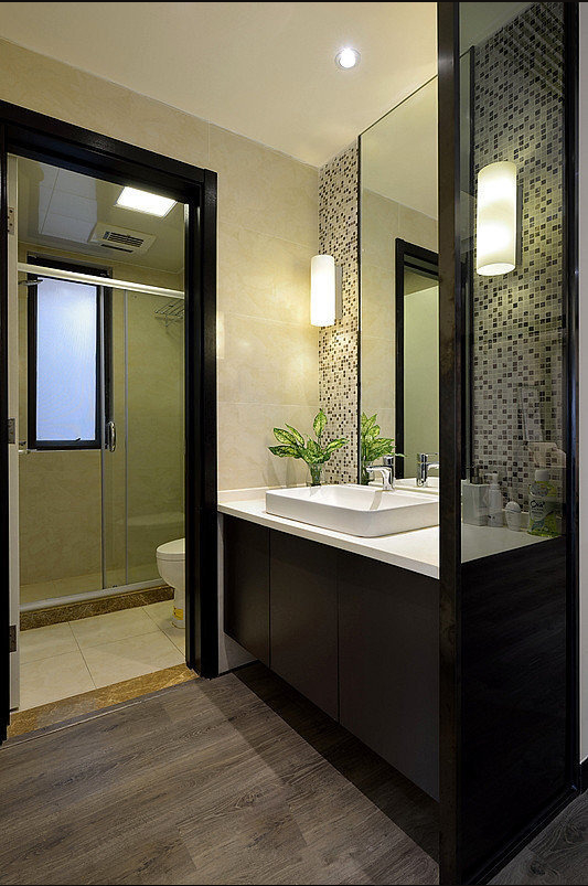 盥洗间的玻璃隔断正好隔绝下与其他空间的重复。