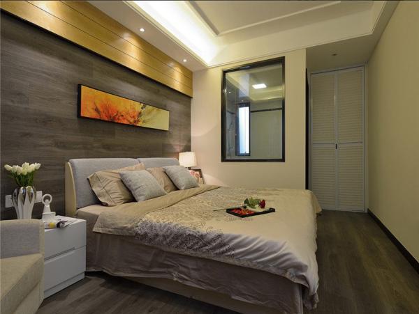 深灰地板做卧室背景墙,再配上一副热情十足的装饰版画,强烈对比,很是特别。