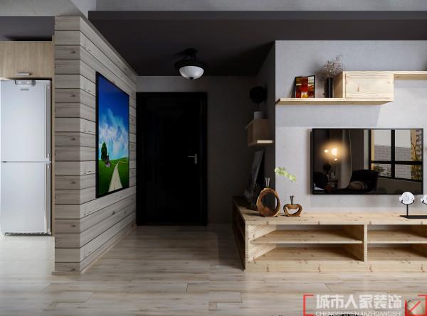 为了弥补户型入口处大门直对主卧的缺陷,玄关处采用电视柜的延伸。,不仅有效阻隔了空间,而且还给空间增加了趣味。