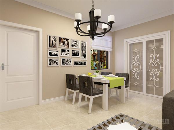 客餐厅整体墙面为暖灰色的乳胶漆墙面,家具的颜色整体以白色为主,在餐厅部分的墙面放了一面照片墙,餐桌为白色烤漆