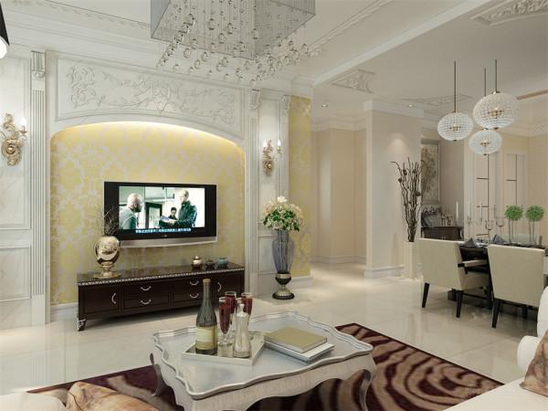 电视背景墙,采用了欧式立柱加上圆拱形的装饰,显得庄重而典雅,墙面用亮金色的壁纸平铺,显得辉煌大气,两边在搭配两盆绿色植物做装饰。使空间增加一点生机。不那么单调