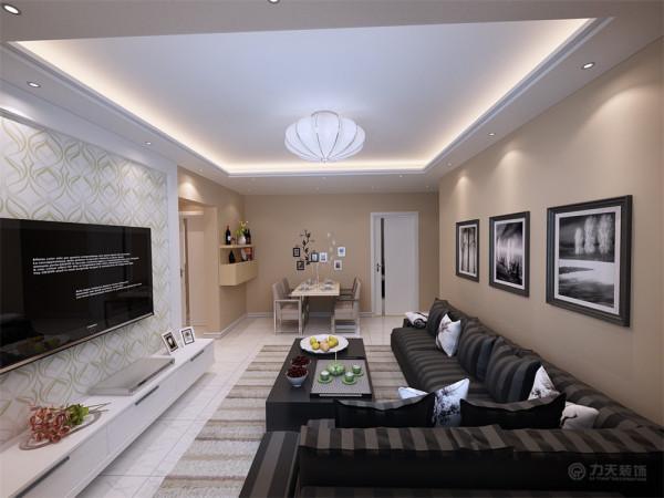 客厅设计采用简约明朗的线条,将空间进行了合理的分隔。整体颜色以简洁的咖色为背景,只有沙发组合几个大件是深色的,在客厅里做 一个色彩对比,显出现代简约的格调。